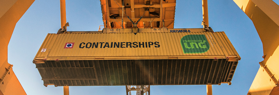 Container being held by a crane