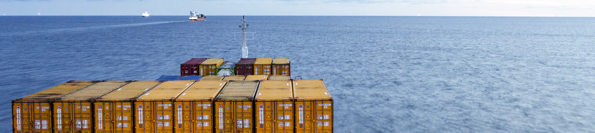 Vessel with containers on the sea